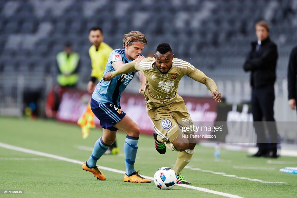 Tim Bjorkstrom of Djurgardens IF and Michael Omoh of Ostersunds FK competes for the ballduring the Allsvenskan match between Djurgardens IF and Ostersunds FK at Tele2 Arena on May 2, 2016 in Stockholm, Sweden.