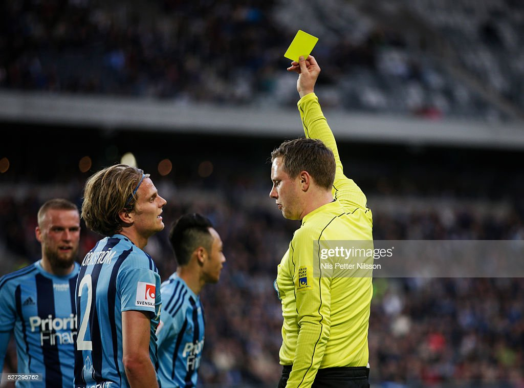 Tim Bjorkstrom of Djurgardens IF is shown a yellow card by Markus Strombergsson, referee, during the Allsvenskan match between Djurgardens IF and Ostersunds FK at Tele2 Arena on May 2, 2016 in Stockholm, Sweden.