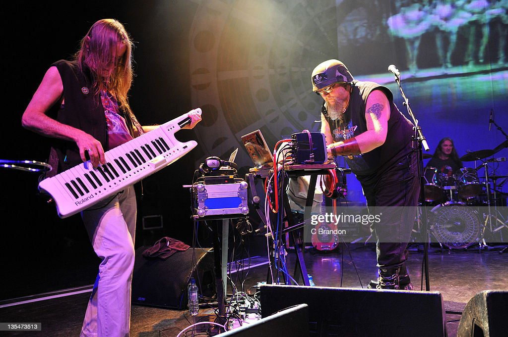 Tim Blake, Mr Dibs and Richard Chadwick of Hawkwind performs on stage at Shepherds Bush Empire on December 10, 2011 in London, England.