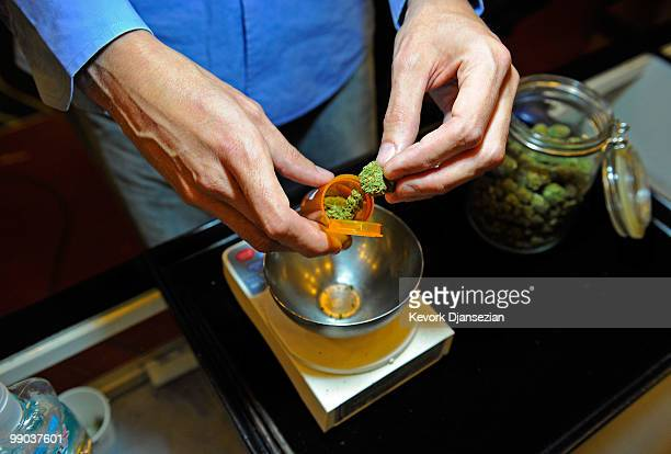 Tim Blakeley manager of Sunset Junction medical marijuana dispensary fills a marijuana prescription on May 11 2010 in Los Angeles California The...