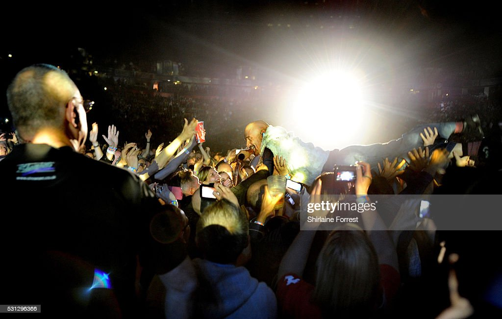 Tim Booth of James crowdsurfs while performing at Manchester Arena on May 13 2016 in Manchester England