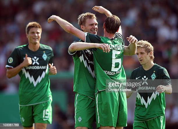 Tim Borowski of Bremen celebrates the third goal with Per Mertesacker during the DFB Cup first round match between Rot Weiss Ahlen and SV Werder...