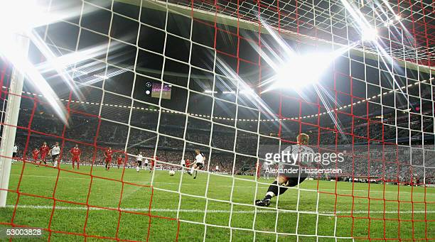 Tim Borowski of the German National Team scores the third goal with a penalty kick during the opening game of the Allianz Arena between Bayern Munich...