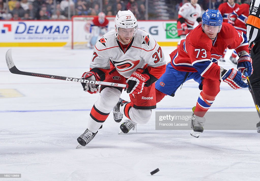 <a gi-track='captionPersonalityLinkClicked' href=/galleries/search?phrase=Tim+Brent&family=editorial&specificpeople=2190959 ng-click='$event.stopPropagation()'>Tim Brent</a> #37 of the Carolina Hurricanes and <a gi-track='captionPersonalityLinkClicked' href=/galleries/search?phrase=Michael+Ryder&family=editorial&specificpeople=208983 ng-click='$event.stopPropagation()'>Michael Ryder</a> #73 of the Montreal Canadiens chase after a loose puck during the NHL game on April 1, 2013 at the Bell Centre in Montreal, Quebec, Canada.