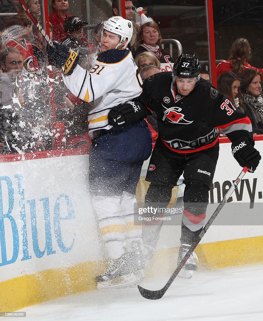 <a gi-track='captionPersonalityLinkClicked' href=/galleries/search?phrase=Tim+Brent&family=editorial&specificpeople=2190959 ng-click='$event.stopPropagation()'>Tim Brent</a> #37 of the Carolina Hurricanes collides along the boards with Brayden McNabb #81 of the Buffalo Sabres during an NHL game on January 6, 2012 at RBC Center in Raleigh, North Carolina.