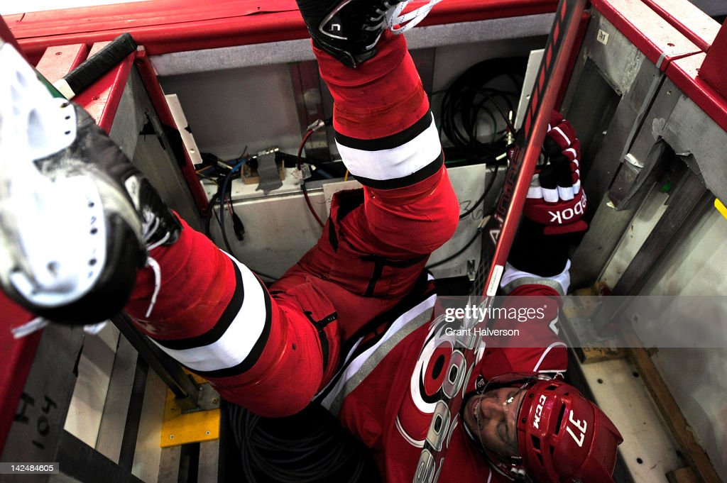 <a gi-track='captionPersonalityLinkClicked' href=/galleries/search?phrase=Tim+Brent&family=editorial&specificpeople=2190959 ng-click='$event.stopPropagation()'>Tim Brent</a> #37 of the Carolina Hurricanes flips over the boards after being checked by the Montreal Canadiens during play at PNC Arena on April 5, 2012 in Raleigh, North Carolina.