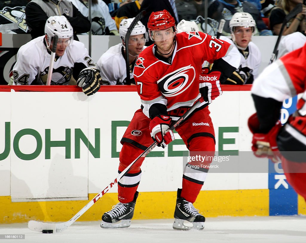 <a gi-track='captionPersonalityLinkClicked' href=/galleries/search?phrase=Tim+Brent&family=editorial&specificpeople=2190959 ng-click='$event.stopPropagation()'>Tim Brent</a> #37 of the Carolina Hurricanes Looks to make a pass during an NHL game against the Pittsburgh Penguins at PNC Arena on April 9, 2013 in Raleigh, North Carolina.