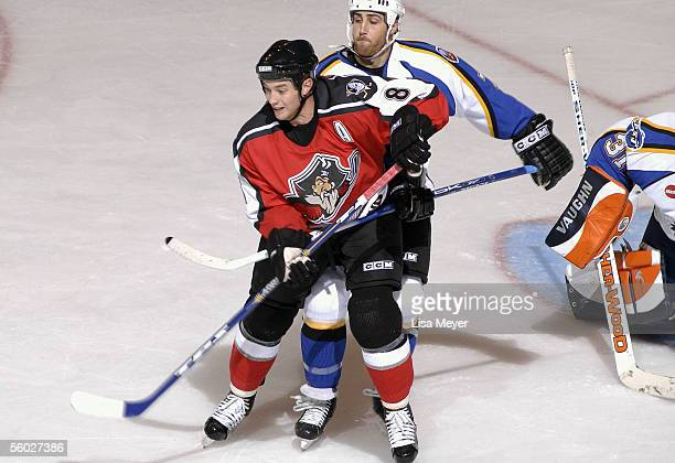 Tim Brent of the Portland Pirates battles for position in the slot against Vince Macri of the Bridgeport Sound Tigers at the Arena at Harbor Yard on...