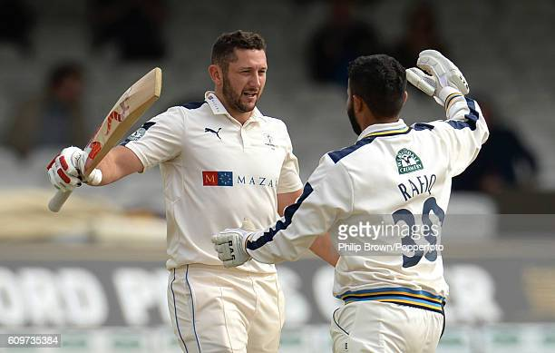 Tim Bresnan and Azeem Rafiq embrace after Bresnan reached his century during day three of the Specsavers County Championship Division One cricket...