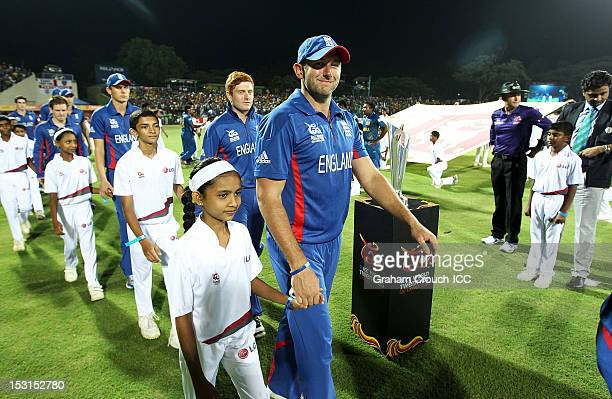 Tim Bresnan of England and a mascot walk onto the arena before the Super Eights Group 1 match between England and Sri Lanka at Pallekele Cricket...