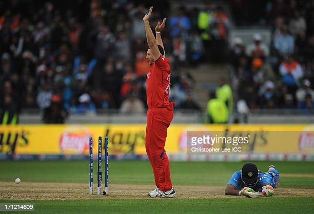 Tim Bresnan of England appeals for the wicket as Ravichandran Ashwin of India is run out by Ian Bell during the ICC Champions Trophy Final match...