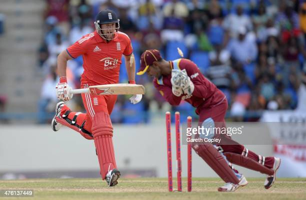 Tim Bresnan of England is run out by West Indies wicketkeeper Denesh Ramdin during the 2nd One Day International between the West Indies and England...