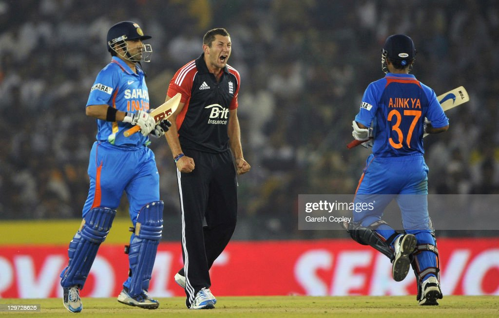 <a gi-track='captionPersonalityLinkClicked' href=/galleries/search?phrase=Tim+Bresnan&family=editorial&specificpeople=571509 ng-click='$event.stopPropagation()'>Tim Bresnan</a> of England reacts as Ajinkya Rahane and <a gi-track='captionPersonalityLinkClicked' href=/galleries/search?phrase=Gautam+Gambhir&family=editorial&specificpeople=707703 ng-click='$event.stopPropagation()'>Gautam Gambhir</a> of India score runs during the 3rd One Day International between India and England at The Punjab Cricket Association Stadium on October 20, 2011 in Mohali, India.