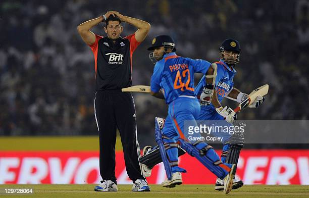 Tim Bresnan of England reacts as Ajinkya Rahane and Parthiv Patel of India score runs during the 3rd One Day International between India and England...