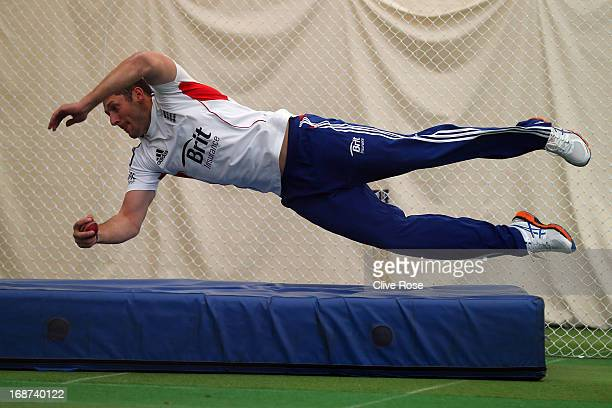 Tim Bresnan of England takes a catch during an indoor training session at Lord's Cricket Ground on May 14 2013 in London England