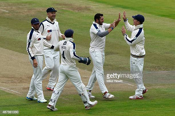 Tim Bresnan of Yorkshire celebrates with team mates after taking the wicket of Sam Robson of Middlesex caught by Alex Lees at first slip for 26...