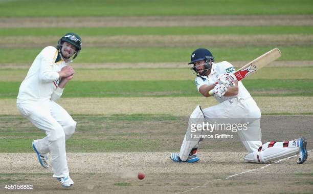 Tim Bresnan of Yorkshire hits out past Mattheus Wessels of Nottinghamshire during the LV County Championship match between Nottinghamshire and...
