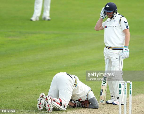 Tim Bresnan of Yorkshire lays on the ground after being hit by a delivery during day four of the Specsavers County Championship division one match...