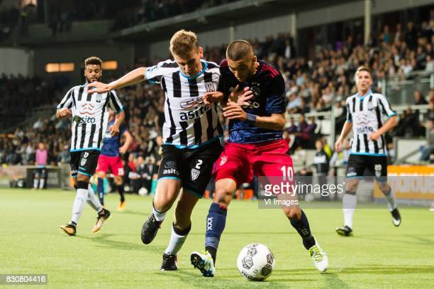 Tim Breukers of Heracles Almelo Hakim Ziyech of Ajax during the Dutch Eredivisie match between Heracles Almelo and Ajax Amsterdam at Polman stadium...
