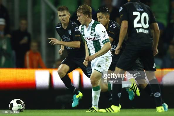 Tim Breukers of Heracles Almelo Simon Tibbling of FC Groningen Joey Pelupessy of Heracles Almelo during the Dutch Eredivisie match between FC...