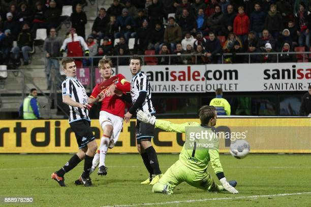 Tim Breukers of Heracles Almelo Wout Weghorst of AZ Alkmaar Dries Wuytens of Heracles Almelo Bram Castro of Heracles Almelo during the Dutch...