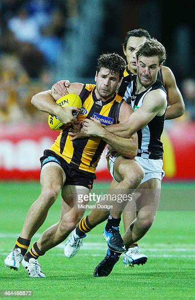 Tim Broomhead of the Magpies tackles Jonathan Simpkin of the Hawks during the NAB Challenge AFL match between Hawthorn Hawks and the Collingwood...