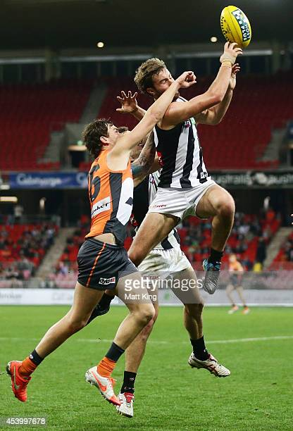 Tim Broomhead of the Magpies takes a mark during the round 22 AFL match between the Greater Western Sydney Giants and the Collingwood Magpies at...