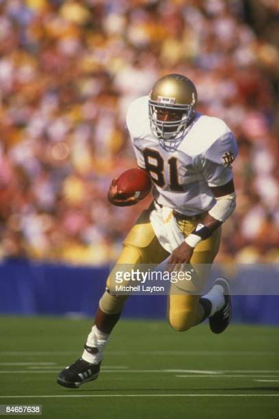 Tim Brown of the Notre Dame Fighting Irish runs with the ball a college football game against the Michigan Wolverines o nSeptember 1 1987 at Notre...