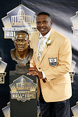 Tim Brown poses with his bust during the NFL Hall of Fame induction ceremony at Tom Benson Hall of Fame Stadium on August 8 2015 in Canton Ohio