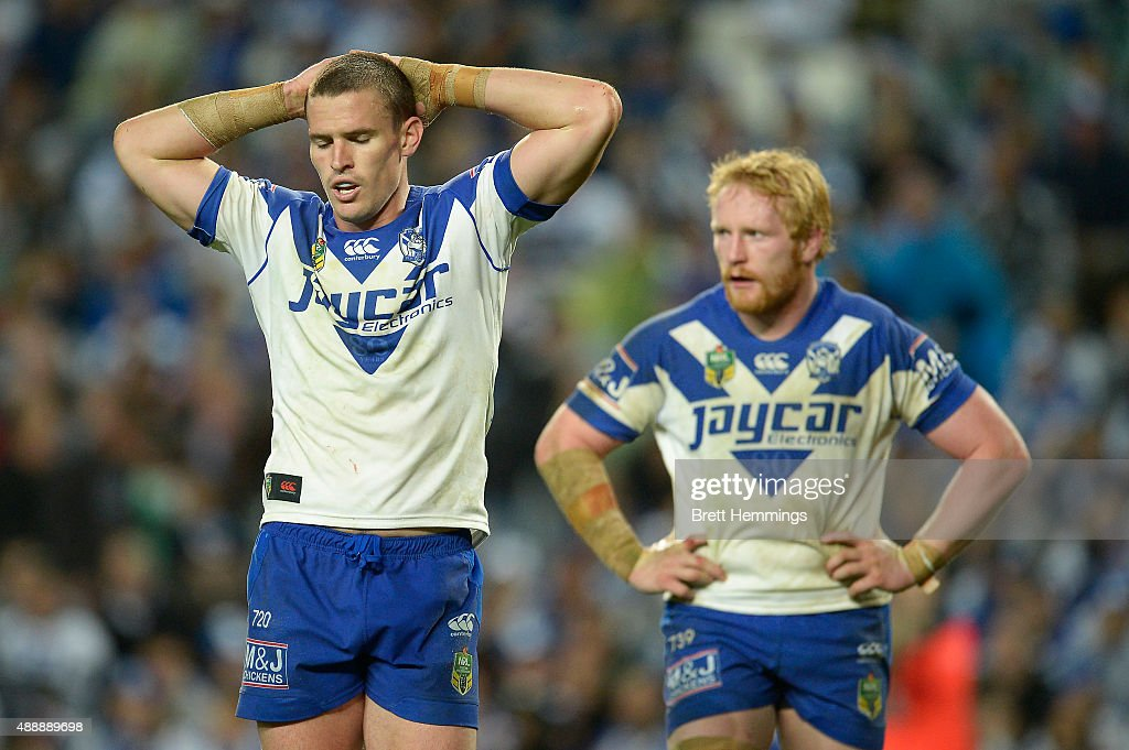Tim Browne (L) and James Graham (R) of the Bulldogs show their dejection during the First NRL Semi Final match between the Sydney Roosters and the Canterbury Bulldogs at Allianz Stadium on September 18, 2015 in Sydney, Australia.