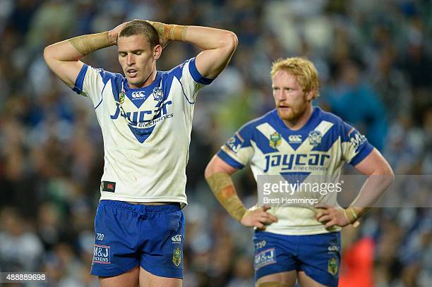 Tim Browne and James Graham of the Bulldogs show their dejection during the First NRL Semi Final match between the Sydney Roosters and the Canterbury...
