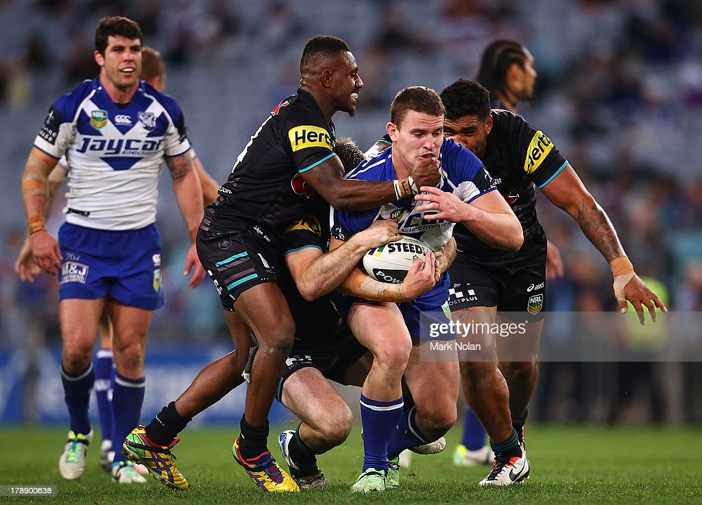 Tim Browne of the Bulldogs is tackled during the round 25 NRL match between the Canterbury Bulldogs and the Penrith Panthers at ANZ Stadium on August 31, 2013 in Sydney, Australia.