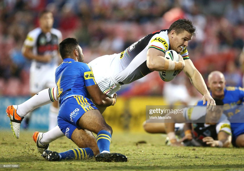 Tim Browne of the Panthers is tackled by Bevan French of the Eels during the NRL Trial match between the Penrith Panthers and Parramatta Eels at Pepper Stadium on February 18, 2017 in Sydney, Australia.