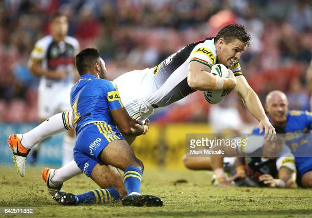 Tim Browne of the Panthers is tackled by Bevan French of the Eels during the NRL Trial match between the Penrith Panthers and Parramatta Eels at...