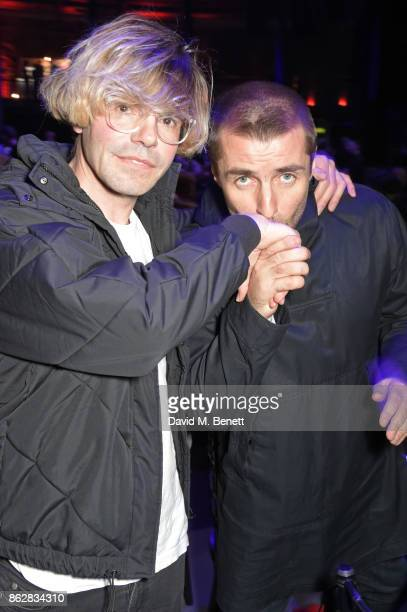 Tim Burgess and Liam Gallagher attend The Q Awards 2017 in association with Absolute Radio at The Roundhouse on October 18 2017 in London England