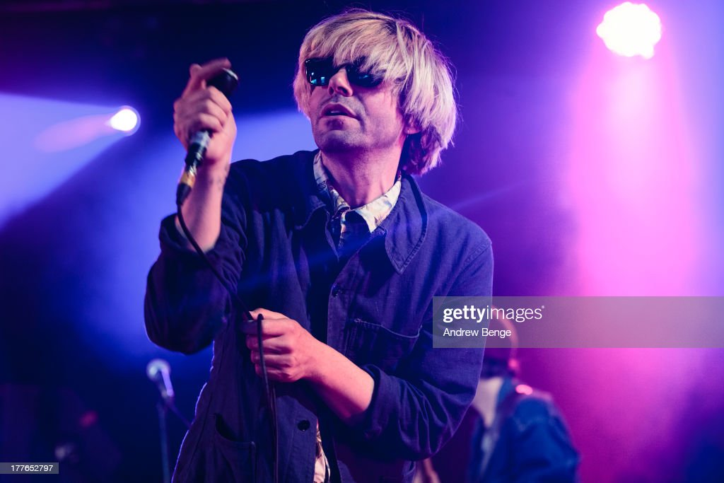 <a gi-track='captionPersonalityLinkClicked' href=/galleries/search?phrase=Tim+Burgess&family=editorial&specificpeople=800430 ng-click='$event.stopPropagation()'>Tim Burgess</a> performs on stage on Day 3 of Leeds Festival 2013 at Bramham Park on August 25, 2013 in Leeds, England.