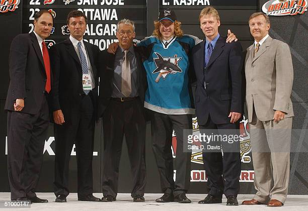 Tim Burke Doug Wilson Karel Masopust #22 overall draft pick Lucas Kaspar Ilkka Sinisalo and Ron Wilson of the San Jose Sharks during the 2004 NHL...