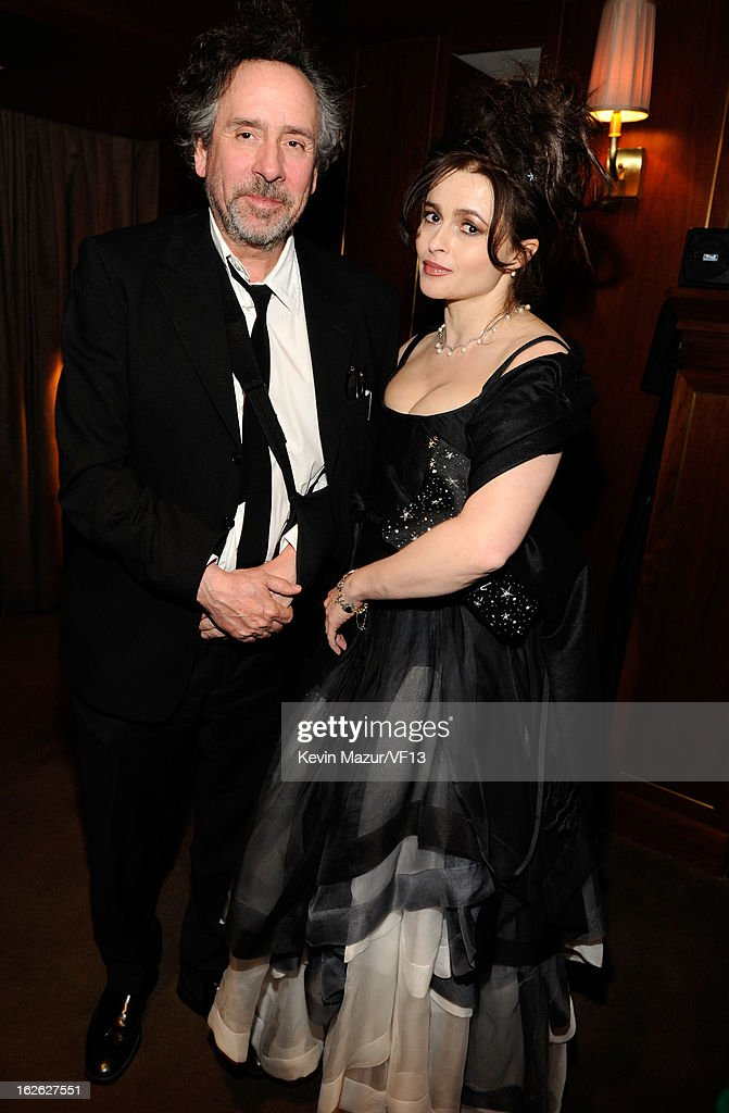 Tim Burton and Helena Bonham Carter attend the 2013 Vanity Fair Oscar Party hosted by Graydon Carter at Sunset Tower on February 24 2013 in West...