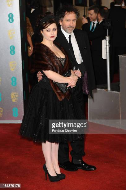 Tim Burton and Helena Bonham Carter attends the EE British Academy Film Awards at The Royal Opera House on February 10 2013 in London England