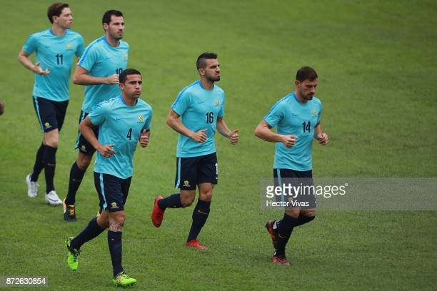 Tim Cahill Alex Gersbach and James Troisi of Australia run during a training session ahead of the leg 1 of FIFA World Cup Qualifier Playoff against...