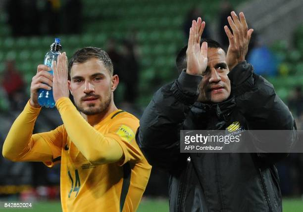 Tim Cahill and James Troisi of Australia applaud following their 21 win in the World Cup 2018 qualifying football match between Australia and...