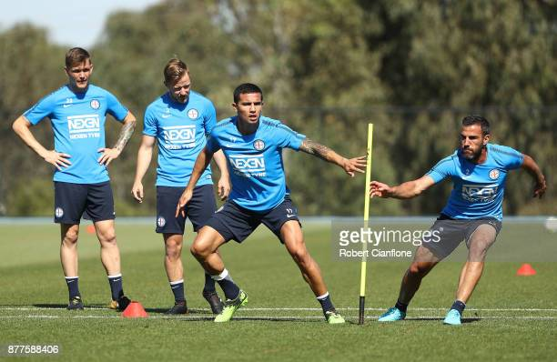 Tim Cahill and Manny Muscat of the City perform a training drill during a Melbourne City ALeague training session at City Football Academy on...