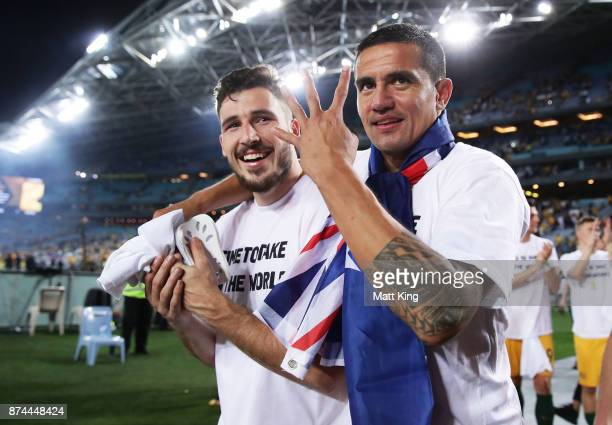 Tim Cahill and Matthew Leckie of Australia celebrate victory after the 2018 FIFA World Cup Qualifiers Leg 2 match between the Australian Socceroos...