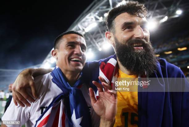 Tim Cahill and Mile Jedinak of Australia celebrate victory after the 2018 FIFA World Cup Qualifiers Leg 2 match between the Australian Socceroos and...