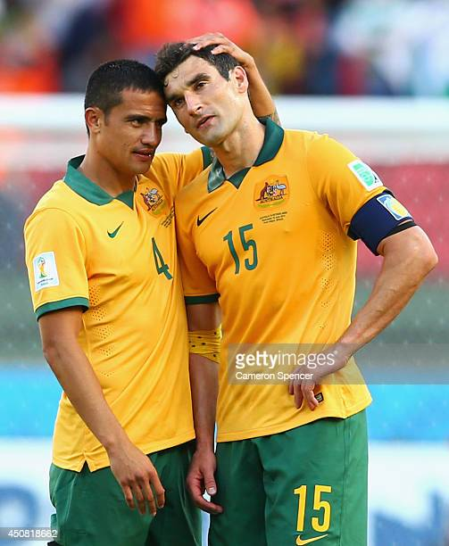 Tim Cahill and Mile Jedinak of Australia react after being defeated by the Netherlands 32 during the 2014 FIFA World Cup Brazil Group B match between...