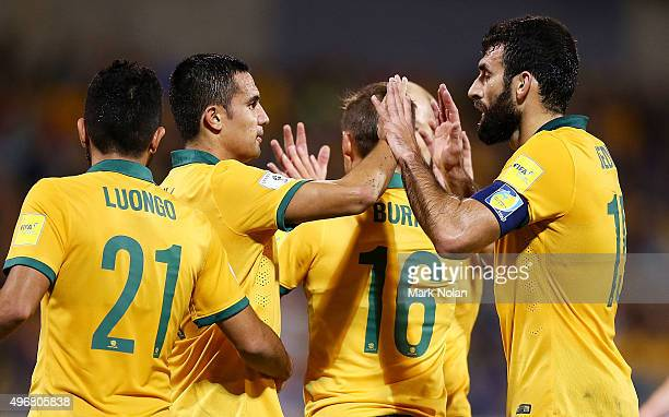 Tim Cahill and Mile Jedinak of the Socceroos celebrate being awarded a penalty shot at goal during the 2018 FIFA World Cup Qualification match...