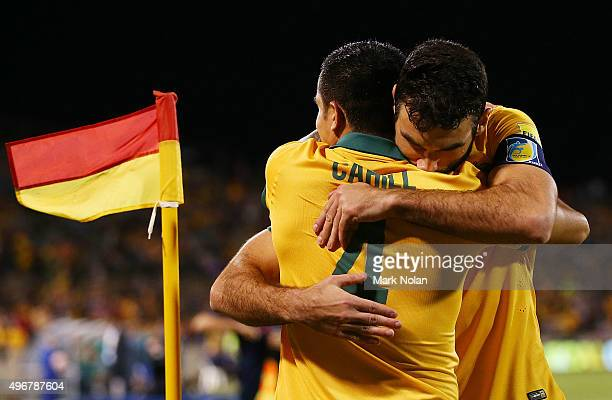 Tim Cahill and Mile Jedinak of the Socceroos embrace after Tim Cahill scored a goal during the 2018 FIFA World Cup Qualification match between the...