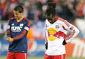 Tim Cahill and Peguy Luyindula of New York Red Bulls react after losing to the New England Revolution for the MLS Eastern Conference Championship at...