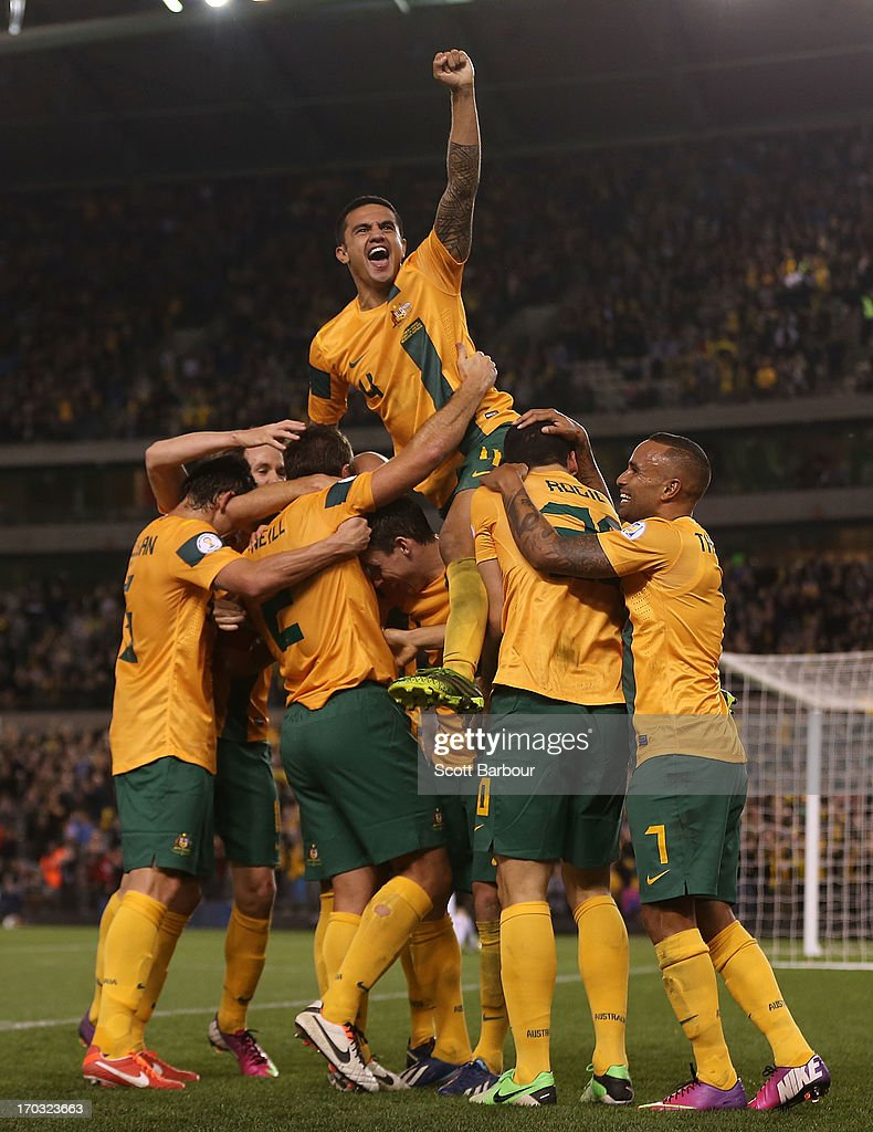 Tim Cahill and the Australians celebrate after Lucas Neill of the Socceroos scored a goal during the FIFA World Cup Qualifier match between the Australian Socceroos and Jordan at Etihad Stadium on June 11, 2013 in Melbourne, Australia.