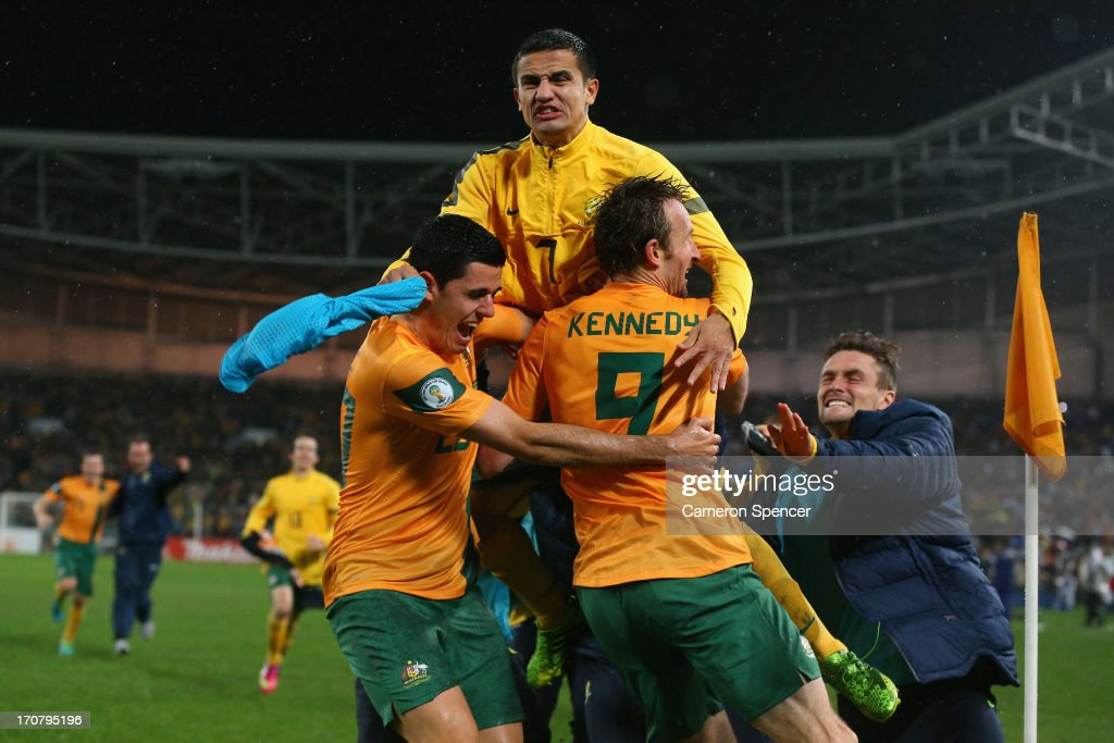 <a gi-track='captionPersonalityLinkClicked' href=/galleries/search?phrase=Tim+Cahill+-+Joueur+de+football&family=editorial&specificpeople=209085 ng-click='$event.stopPropagation()'>Tim Cahill</a> and Tomas Rogic of the Socceroos celebrate with team mate Josh Kennedy after Kennedy scored a goal during the FIFA 2014 World Cup Asian Qualifier match between the Australian Socceroos and Iraq at ANZ Stadium on June 18, 2013 in Sydney, Australia.